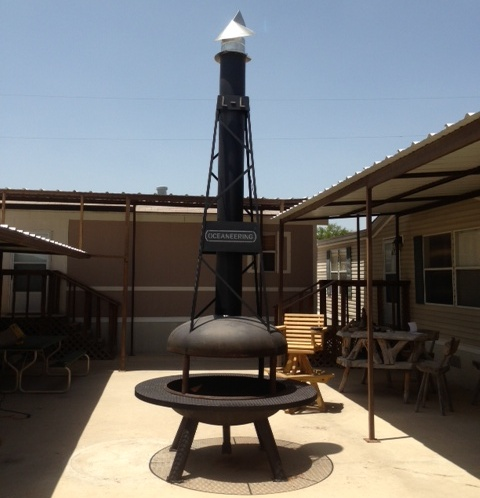 wind chimney cap on a fire pit