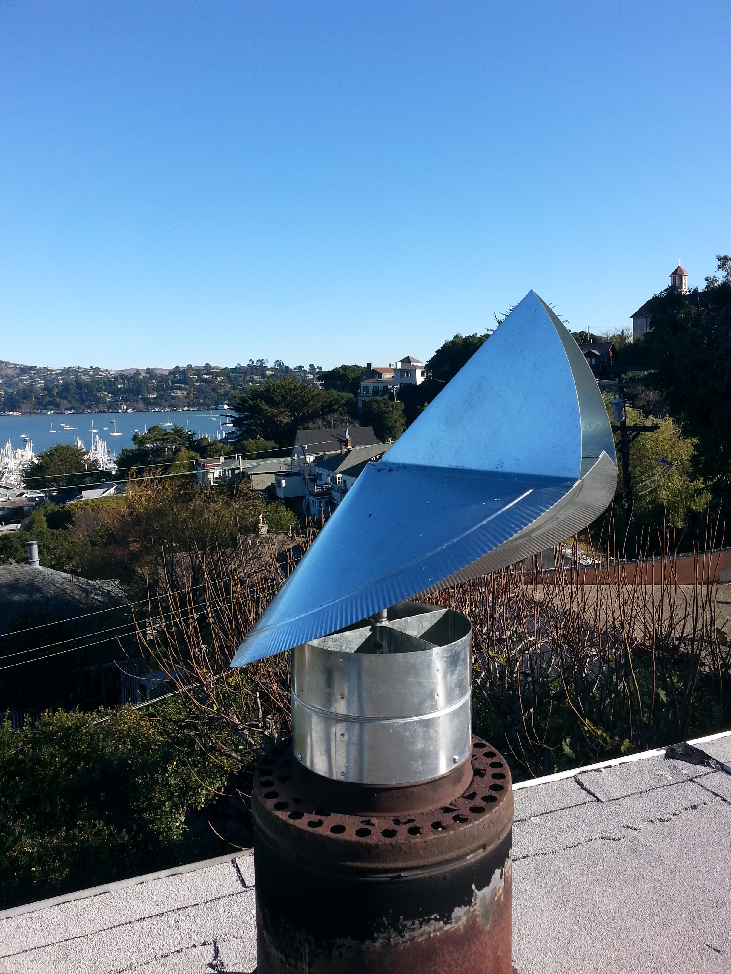 Revolving Wind Blocking Chimney Cap Installed