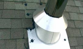 Metal storm collar and pipe flashing on roof