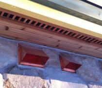copper range and bath vents on stone siding